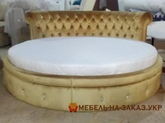 круглая желтая кровать с коретной стяжкой