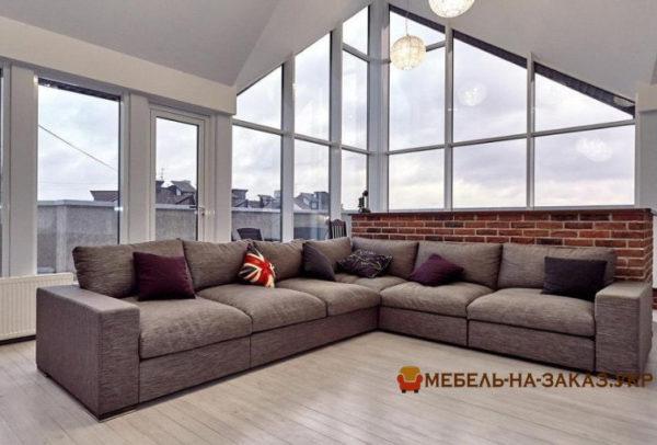 авторский угловой диван в гостиную с пуфиком на заказ